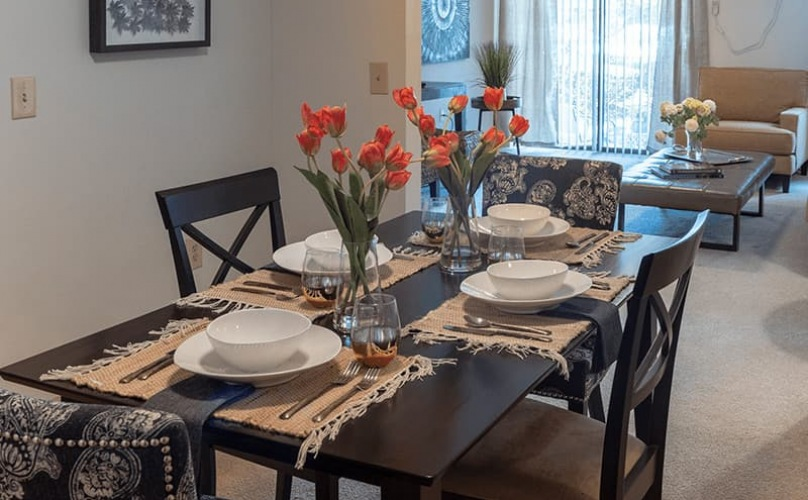 spacious table in dining room that connects to other rooms