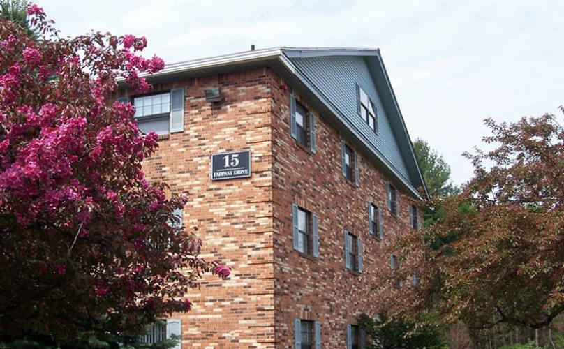 outside view of property showing brick accents and landscaping