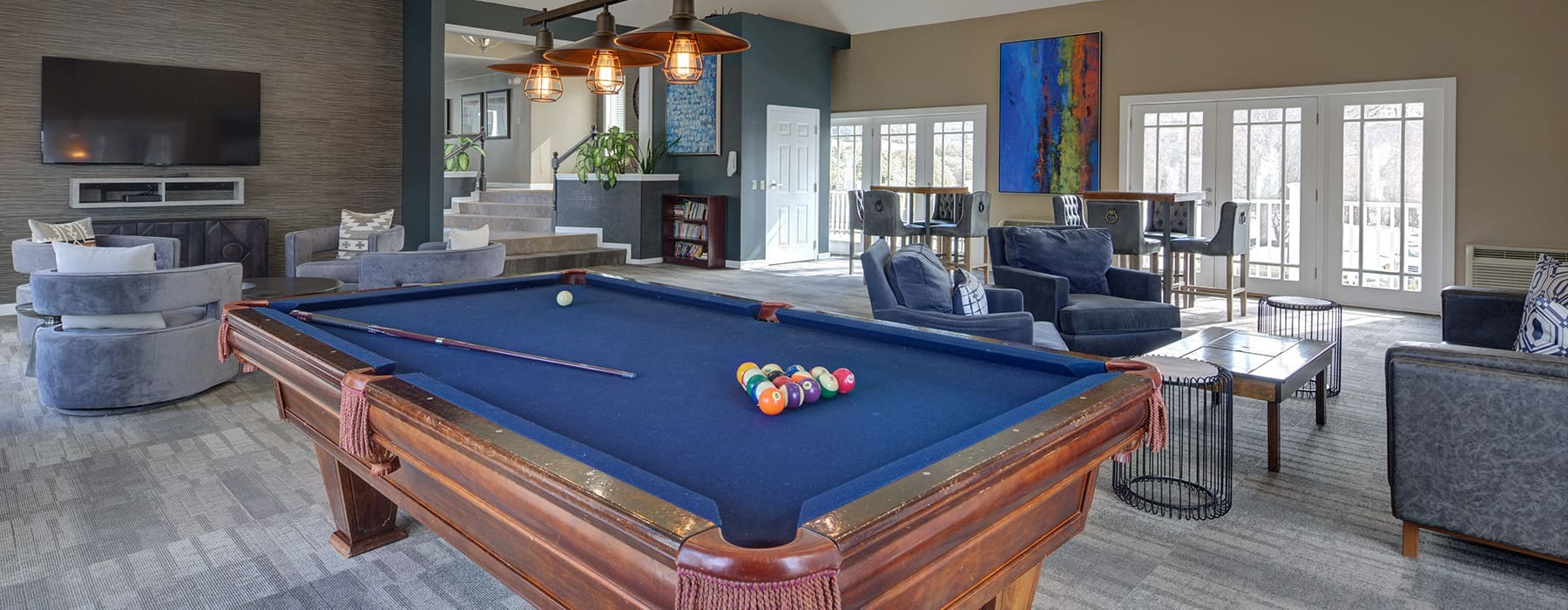 spacious clubroom with a pool table and modern design